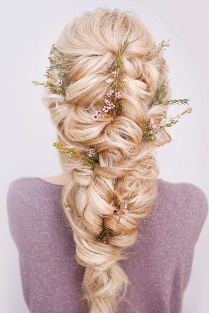 Braid Hairstyle with Floral Accessory