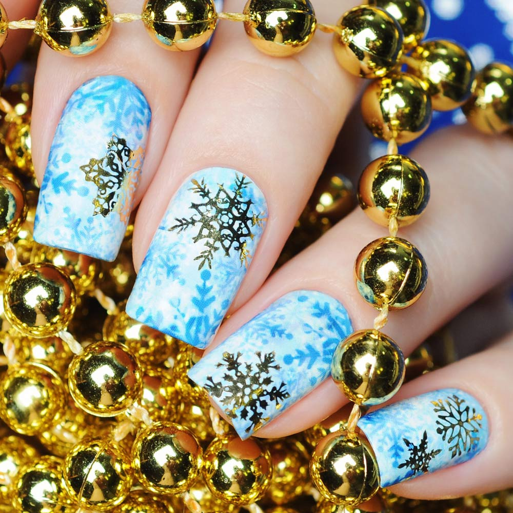 Bright Christmas Nails with Gold Snowflakes