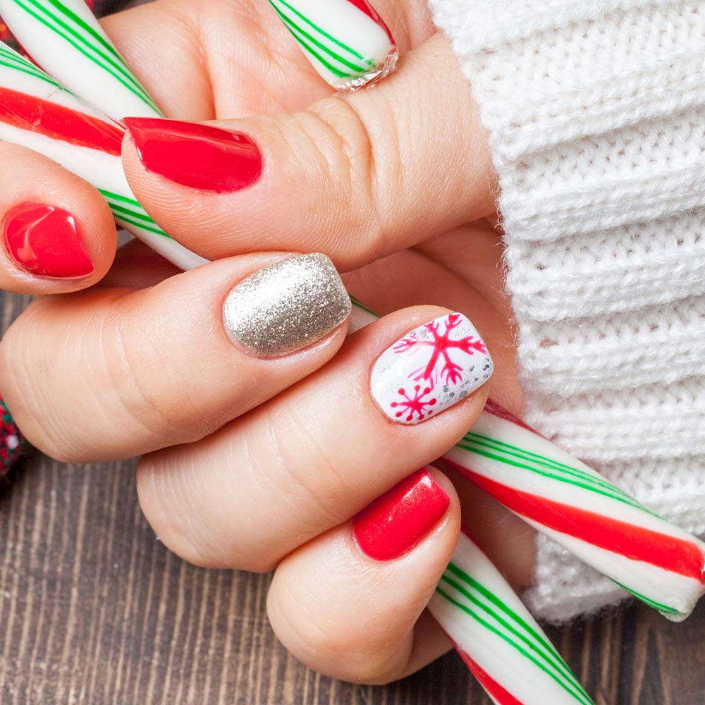 Red and White Snowflake Nail Design with Accented Finger