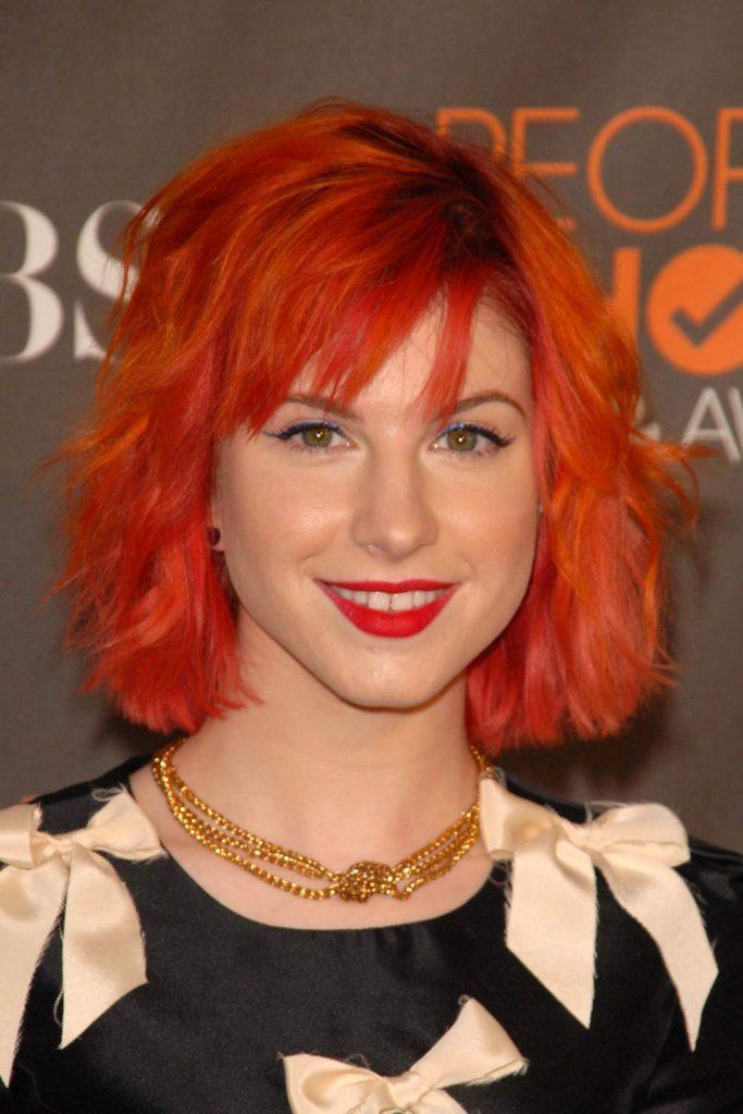 Hayley Williams with Bright Orage Hair Color
