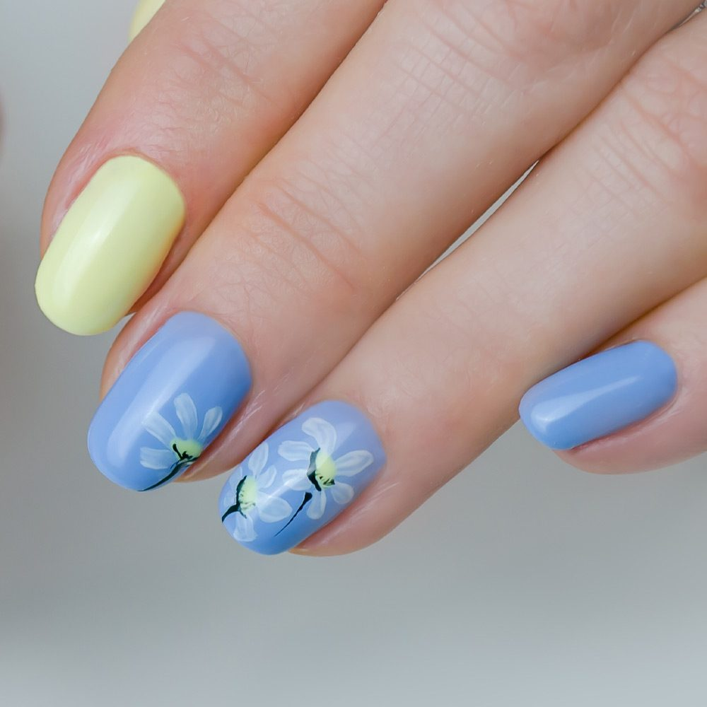 Pastel Blue Nails with Flowers