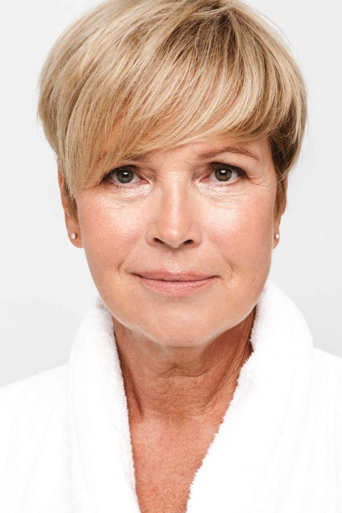 Round Blonde Pixie with Side Bangs