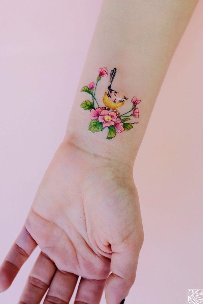 Wrist Tattoo with Flowers and Bird