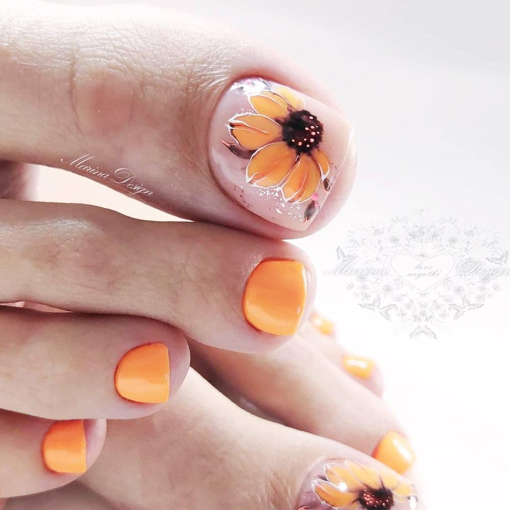 Orange Toe Nails with Flower