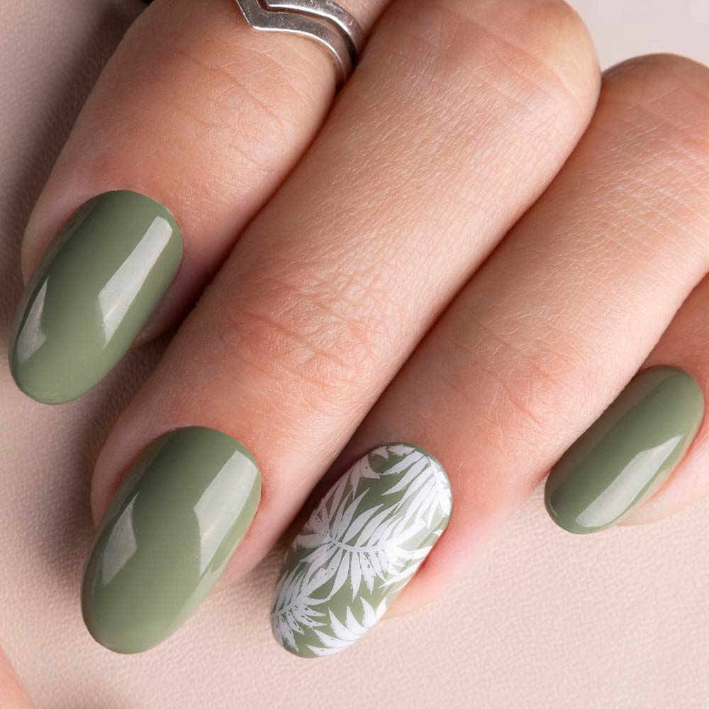 Green Nails with Accent White Nail