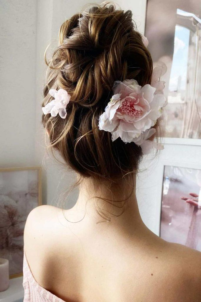 Updo Hairstyle with Floral Accessory